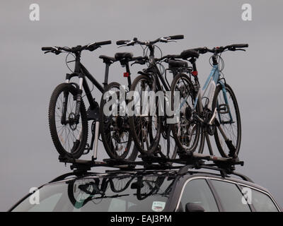Bicycles on a car roofrack, UK - Stock Image