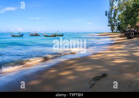 Boats at anchor  at Nai Yang beach, Phuket, Thailand - Stock Image