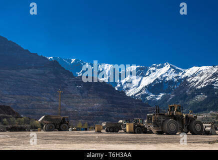 Heavy Truck And Bulldozer At Open Cast Ore Mine - Stock Image