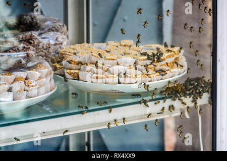 Bees in local sweet in the Medina of Marrakech, Morocco - Stock Image