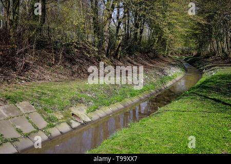 25.03.2019, Essen, North Rhine-Westphalia, Germany - The Berne is a small river that rises in the city of Essen and flows into the Emscher. The canali - Stock Image
