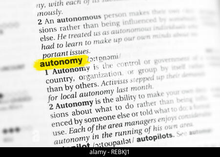 Highlighted English word 'autonomy' and its definition at the dictionary. - Stock Image