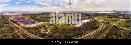 Liddell and Bayswater power stations in Hunter valley black coal mining region of Australia - elevated wide aerial panorama of industrial landscape wi - Stock Image