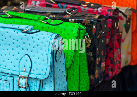 Range of colorful handbags for retail sale at a local market stall or smallholders independent shop display. - Stock Image