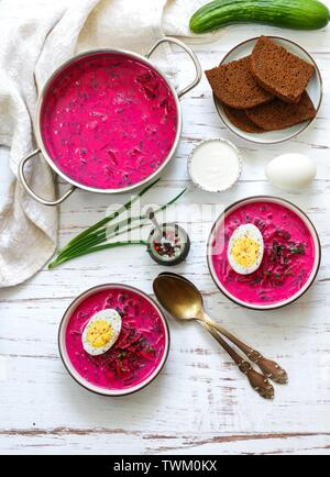 Beetroot soup. Holodnik. Cold summer vegetarian dish of bees, cucumbers, potatoes, eggs, green onions, dill and parsley with kefir or sour cream. Trad - Stock Image