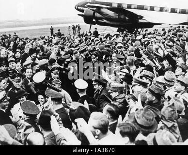 Reception of the crew of a Focke-Wulf FW 200 Condor after a non-stop flight from New York to Berlin-Tempelhof. In the middle, the fighter pilot, aircraft designer and later Chief of Aircraft Procurement and Supply of the Luftwaffe, Ernst Udet. - Stock Image