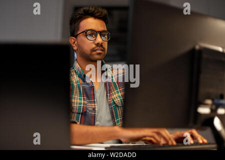 close up of creative man working at night office - Stock Image
