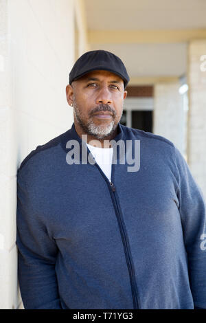 African American man standing alone looking sad. - Stock Image