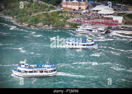 Niagara Falls, USA – August 29, 2018: American and Canadian ferry with tourists of the boat in tour Horseshoe waterfall Niagara Falls - Stock Image