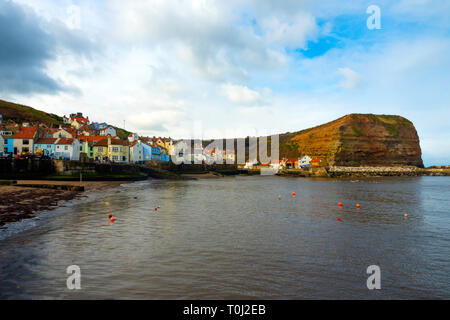 Staithes village and harbour looking towards Cow Bar Nab  North Yorkshire UK on an early spring day before the start of the holiday season - Stock Image