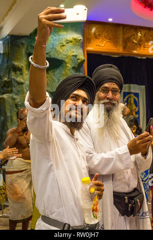 Batu Caves, Sikh Visitors Taking a Selfie, Selangor, Malaysia. - Stock Image