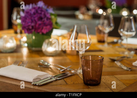 'Place setting on wooden table in salon of The Zetter Hotel in London, England' - Stock Image