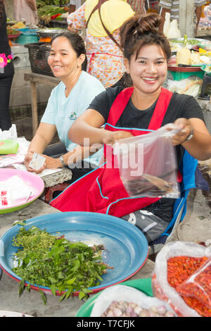 Nakhon SI Thammarat, Thailand-February 11th 2015.  A fresh vegetable vendor on the market. The market is open every morning. - Stock Image