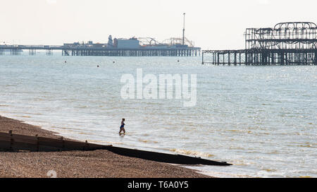 Brighton, UK. 30th Apr, 2019. A swimmer takes a dip off Hove seafront this morning as they enjoy the warm sunny weather with it forecast to reach into the high teens in some parts of the South East today. Credit: Simon Dack/Alamy Live News - Stock Image