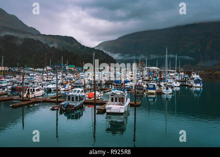 View of a harbor with lots of boats, Whittier, Alaska, USA - Stock Image