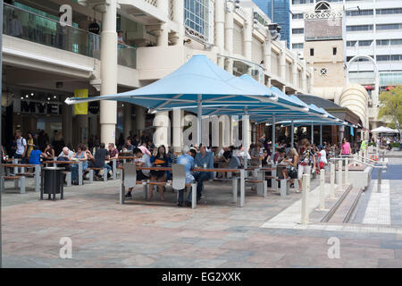 People eating lunch and socialising in Forrest Chase, a pedestrian mall precinct in the centre of Perth, Western - Stock Image
