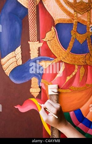 Thailand, Bangkok. Murals of the Ramakian being restored at Wat Phra Kaew (Temple of the Emerald Buddha). - Stock Image