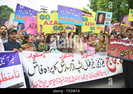 Lahore, Pakistan. 23rd June, 2019. Pakistani members of Christian community are holding placards banners shout slogan against Arch Bishop Azad Marshal in Lahore. Azad Marshall is a Pakistani-born Anglican bishop. He is the sixth Bishop of the Anglican Church in the Islamic Republic of Iran, a diocese of the Episcopal Church in Jerusalem and the Middle East in the Anglican Communion, since 2007.He is married to Lesley, who directs a ministry to underprivileged women in Pakistan. Credit: Rana Sajid Hussain/Pacific Press/Alamy Live News - Stock Image