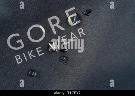 Goretex fabric with water droplets. Water resistant technical fabric. - Stock Image