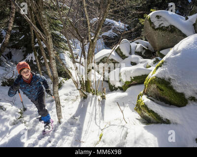 High angle view of a Girl snowshoeing in Black Forest, Germany, Europe - Stock Image