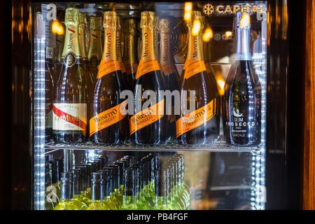 Fridge in a pub with white wine, prosecco, champane, - Stock Image