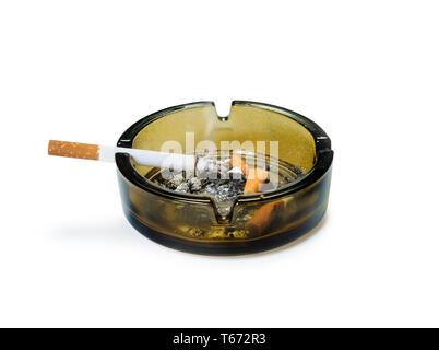 Ashtray with smoking cigarettes on it and butts inside. Isolated with clipping path - Stock Image