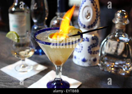 Flaming margarita on the bar at a Mexican restaurant - Stock Image