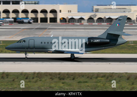 Dassault Falcon 2000 business jet operated by Sirio SpA on the runway at Malta International Airport - Stock Image