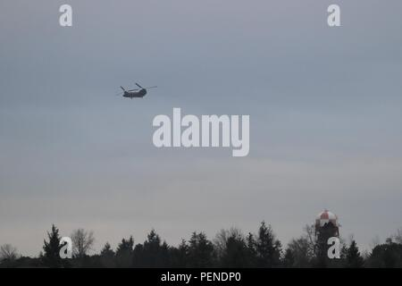 A U.S. Army CH-47 Chinook assigned to 16th Combat Aviation Brigade departs from Joint Base Lewis-McChord, Wash., for the National Training Center Jan. 9, 2016. The Soldiers and aircraft will participate in training with other units from 7th Infantry Division to prepare for future missions. (U.S. Army photo by Capt. Brian Harris/Released) - Stock Image