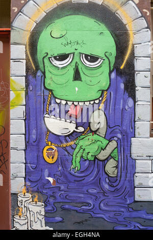 Graffiti image of a humanoid being on an alley wall in the city of Perth, Western Australia. - Stock Image