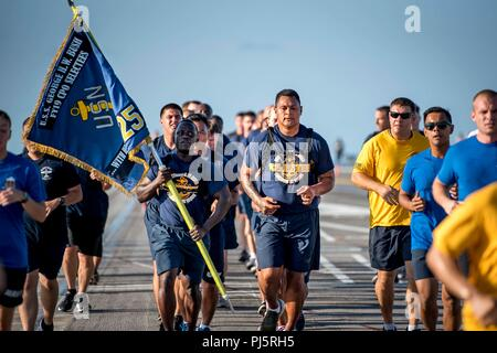 180826-N-SO730-0137 ATLANTIC OCEAN (Aug. 26, 2018) Chief petty officer selectees assigned to the aircraft carrier USS George H.W. Bush (CVN 77) participate in a 5k fun run on the flight deck. The ship is underway conducting routine training exercises to maintain carrier readiness. (U.S. Navy photo by Mass Communication Specialist 3rd Class Joe Boggio) - Stock Image