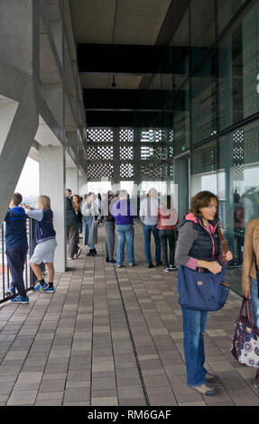 Visitors to the 10th floor viewing platform at the Switch House Extension, Tate Modern, South Bank, London, UK - Stock Image