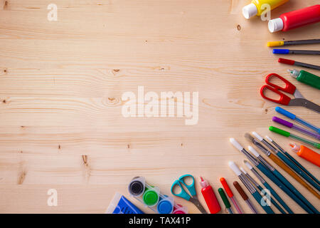 School supplies on wooden board background. Back to school concept - Stock Image