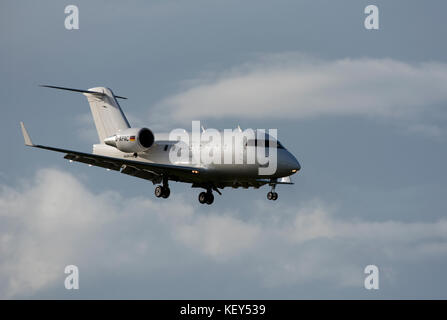A Bombardier Challenger 604 business jet approaches the airfield at Inverness Dalcross Airport in Highland Region - Stock Image