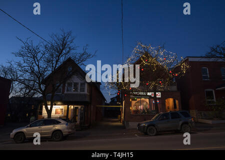 OTTAWA, CANADA - NOVEMBER 10, 2018: Typical north American wooden houses in a residential street in autumn in Ottawa, Ontario, during an autumn night  - Stock Image