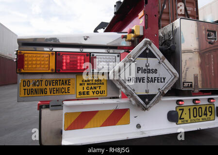 Rear tail lights and safety stickers or decals on a semi trailer truck - Stock Image