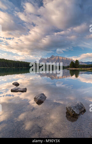 First light on Mount Rundle from the reflective waters of Two Jack Lake, Banff National Park, Alberta, Canada. Autumn (September) 2017. - Stock Image