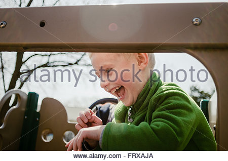 Happy kid at the playground - Stock Image