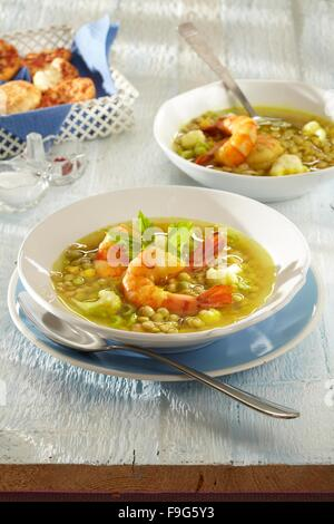 Lentil soup with shrimps - Stock Image