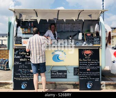 The shellfish pot selling seafood on the coast in Teignmouth, South Devon - Stock Image