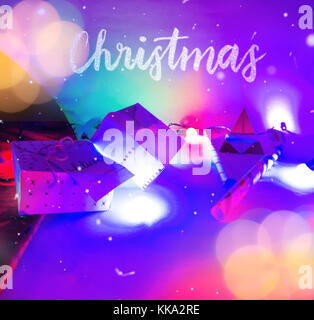 Christmas Decoration with Gifts and colorful Lights with bokeh effect  and candy cane background image for invitation - Stock Image