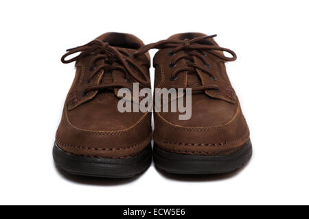 A pair of oxford style shoes with tied laces - Stock Image