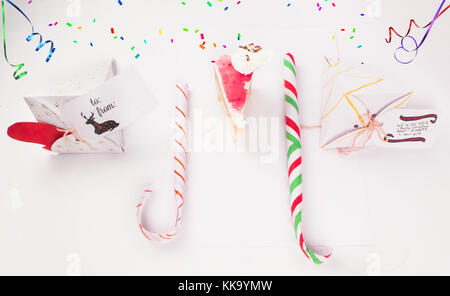 Christmas Decoration with cake slice gift boxes with cake piece and confetti falling for best background image for - Stock Image