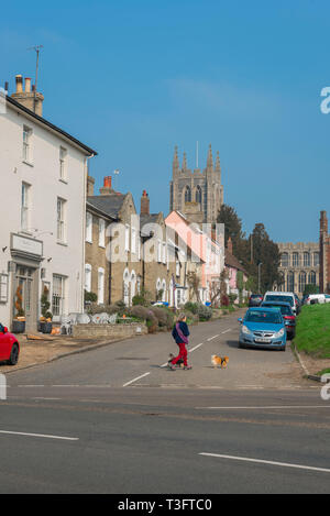 Long Melford Suffolk, view of Church Walk and the tower of Holy Trinity Church in the Suffolk village of Long Melford, England, UK. - Stock Image
