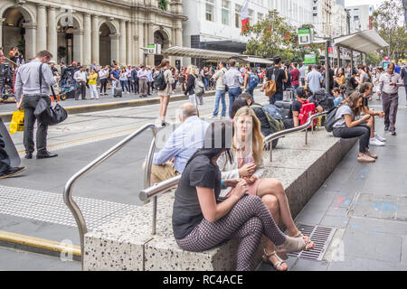Melbourne, Australia - 21st February 2018: People on Bourke Street. The street is in the heart of the main shopping area. - Stock Image