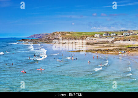 6 July 2018: Bude, Cornwall, UK - Crowds cooling off in the sea during the summer heatwave. - Stock Image