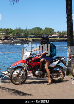 Woman and child on Honda 150L motorcycle in Chile 2019 - Stock Image