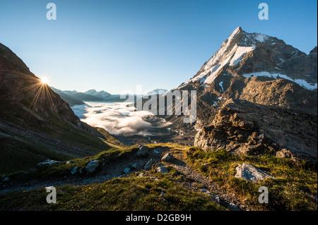 Matterhorn mountain peak view from SAC mountain hut Schoenbiel at sunrise, Zermatt, Switzerland - Stock Image
