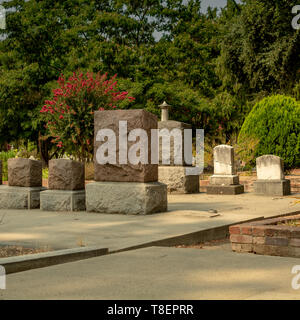 Graveyards in cemetery with places for names on the tombstone - Halloween composition with space for names and inscriptions - Stock Image