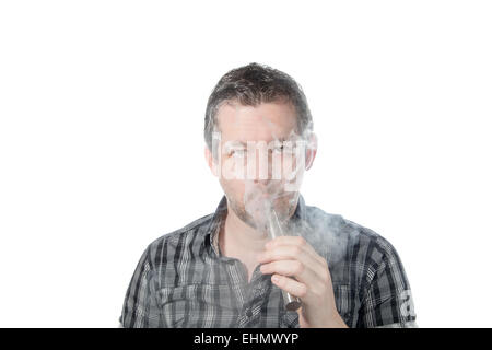 Picture of a man smoking on a e cigarette with smoke beeing exhaled - Stock Image